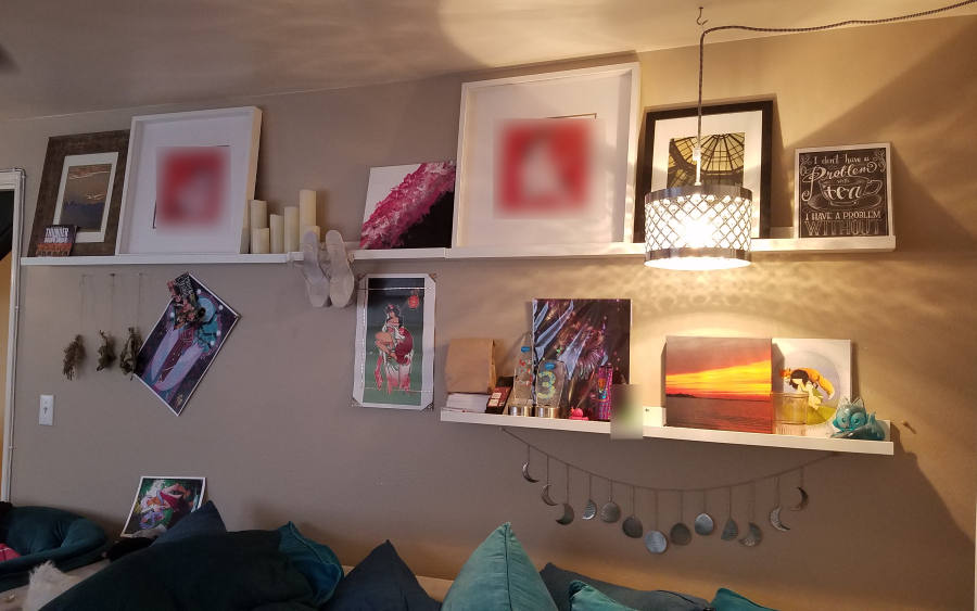 white ikea mosslanda picture ledges on a wall with colorful art